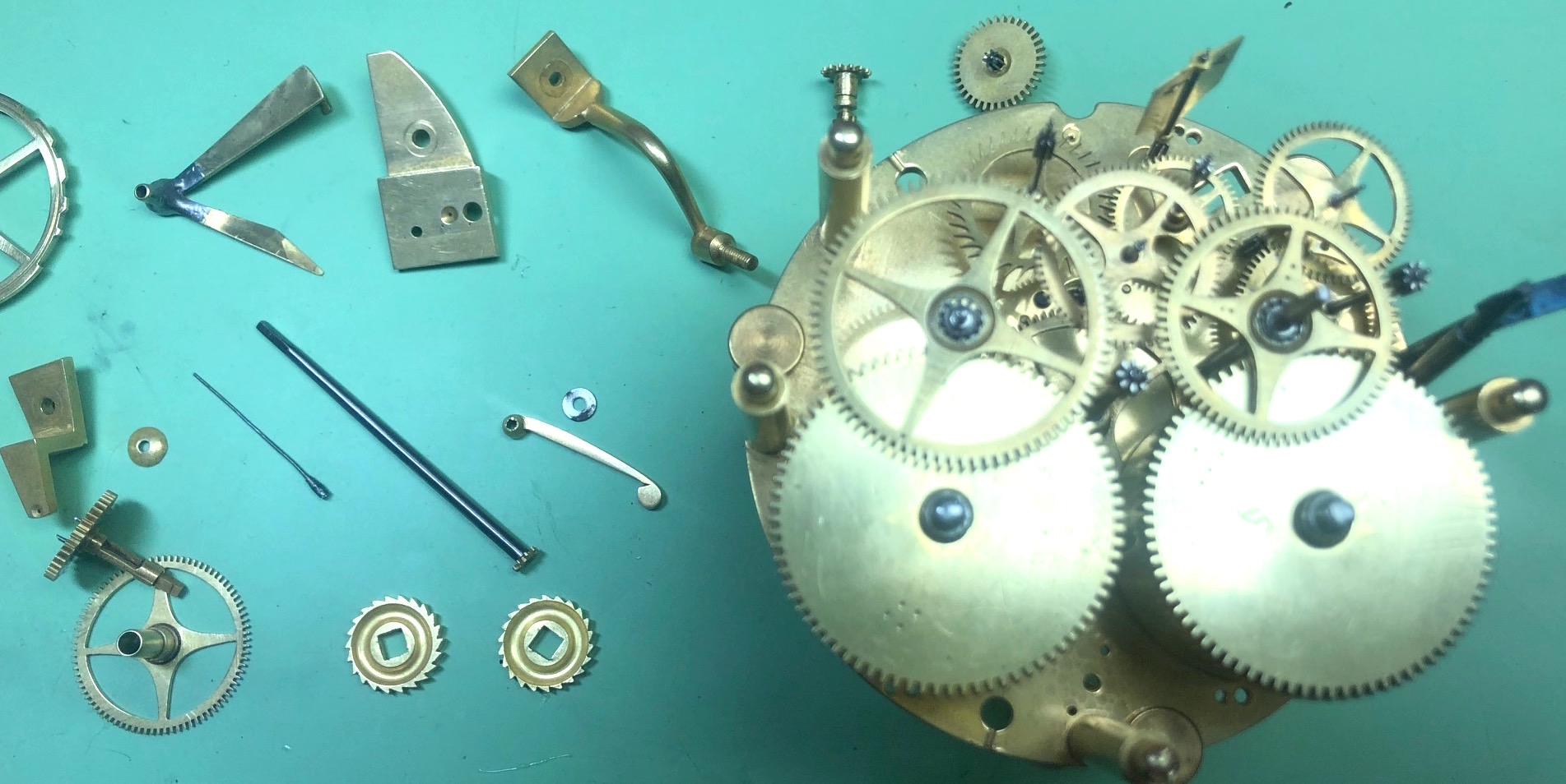 Wheels Going Back In  Antique Clock Repair & Servicing